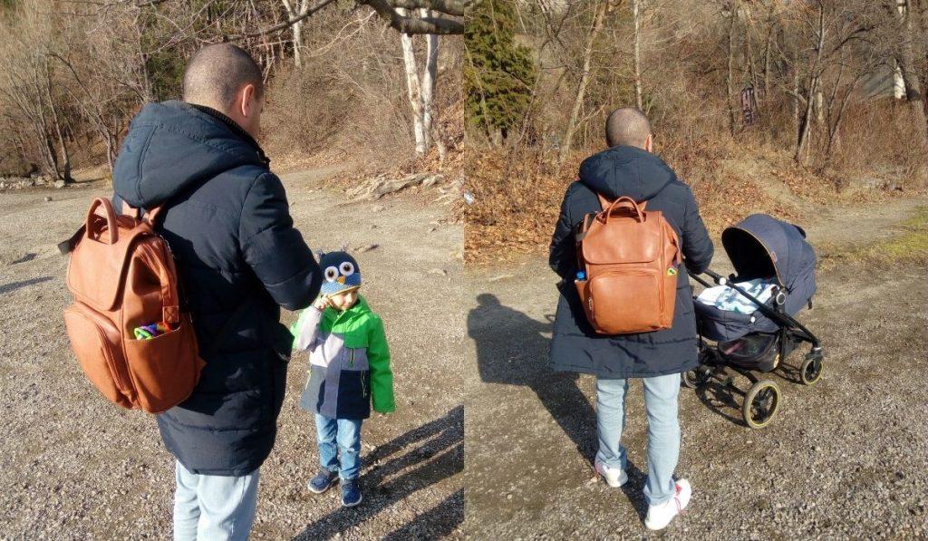 wickelrucksack test - papa trägt die leder tasche - spaziergang mit baby und kleinkind